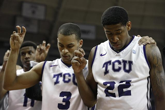 TCU guards Clyde Smith III (3) and Jarvis Ray (22) listen to the school song after an NCAA college basketball game against Oklahoma Saturday, March 8, 2014, in Fort Worth, Texas. TCU went 0-18 this season with Oklahoma winning 97-67. (AP Photo/Sharon Ellman)