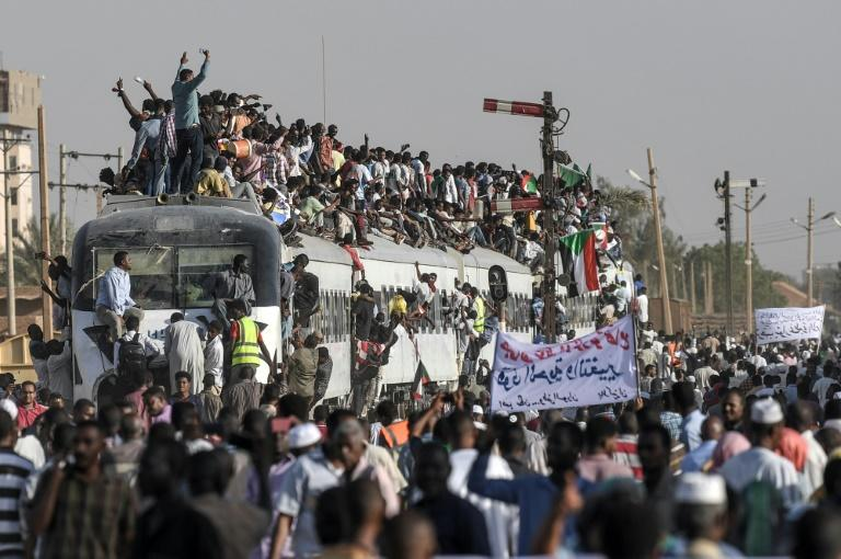 Sudanese protesters from the city of Atbara, the crucible of the protests, cheer upon arriving in Khartoum on April 23, 2019