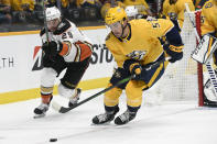 Anaheim Ducks center Devin Shore (29) and Nashville Predators defenseman Dante Fabbro (57) chase the puck during the first period of an NHL hockey game Tuesday, Oct. 22, 2019, in Nashville, Tenn. (AP Photo/Mark Zaleski)