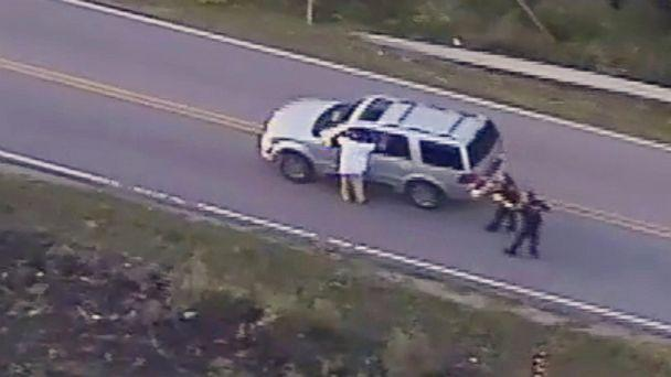 PHOTO: In this Sept. 16, 2016 image made from video provided by police, Terence Crutcher, left, with his arms held up, is pursued by police officers as he walks next to his stalled SUV before he was shot and killed by one of the officers in Tulsa, Okla. (Tulsa Police Department via AP)