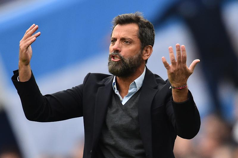Watford's Spanish head coach Quique Sanchez Flores gestures during the English Premier League football match between Tottenham Hotspur and Watford at Tottenham Hotspur Stadium in London, on January 1, 2019. (Photo by Glyn KIRK / AFP) / RESTRICTED TO EDITORIAL USE. No use with unauthorized audio, video, data, fixture lists, club/league logos or 'live' services. Online in-match use limited to 120 images. An additional 40 images may be used in extra time. No video emulation. Social media in-match use limited to 120 images. An additional 40 images may be used in extra time. No use in betting publications, games or single club/league/player publications. / (Photo by GLYN KIRK/AFP via Getty Images)