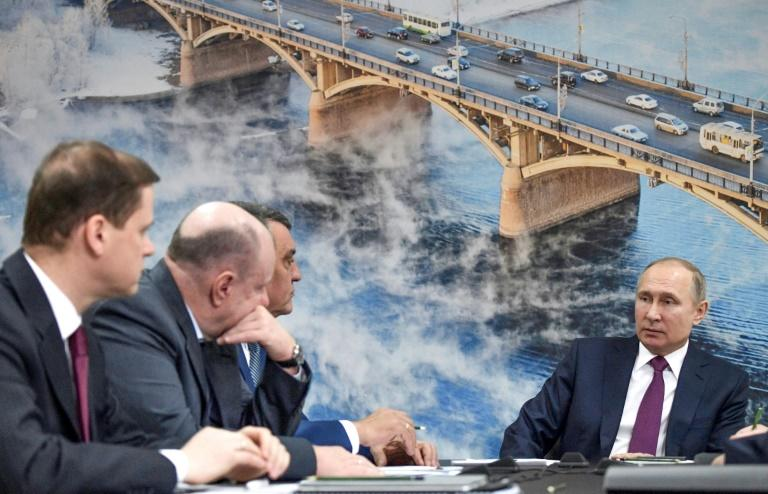 Russian President Vladimir Putin (R) called for a plan to improve the dire ecological situation during a visit to Krasnoyarsk on February 7, 2018