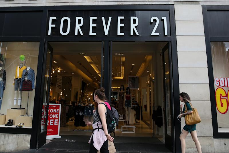 LONDON, UK - 09/08/2009: Shoppers walk past a branch of the Forever 21 store in central London. (Photo by Steve Taylor / SOPA Images / LightRocket via Getty Images)