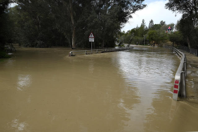 Pedieos River floods a main road after heavy rainfall overnight, in capital Nicosia, Cyprus, Wednesday Jan. 16, 2019. Cyprus is in the grip of a mid-winter storm bringing heavy rains, low temperatures and snow in the Troodos mountain range. (AP Photo/Petros Karadjias)