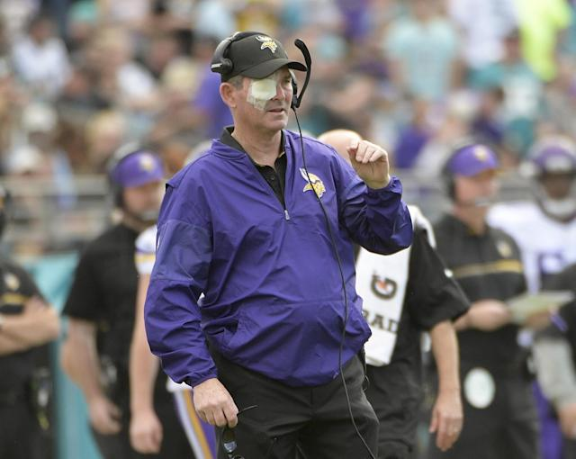 Mike Zimmer's latest eye surgery will keep him out for the Vikings OTAs this week. (AP)