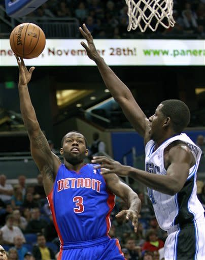 Detroit Pistons' Rodney Stuckey (3) takes a shot over Orlando Magic's Andrew Nicholson, right, during the first half of an NBA basketball game, Wednesday, Nov. 21, 2012, in Orlando, Fla. (AP Photo/John Raoux)