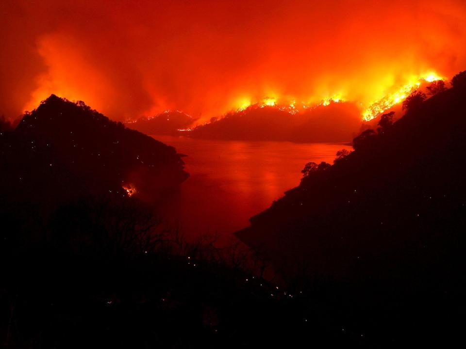 Flames surround Lake Berryessa from the Markley fire, which became part of the Lightning Complex (Getty)