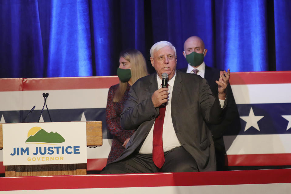 West Virginia Gov. Jim Justice celebrates his reelection at The Greenbrier Resort, Tuesday, Nov. 3, 2020, in White Sulphur Springs, W.Va. Justice and his staff are being tested for the coronavirus after a staffer in the capitol building tested positive on Friday, Nov. 6. Justice says he was tested minutes before a noon press conference where he announced a record 540 new coronavirus cases in the past day. (AP Photo/Chris Jackson)