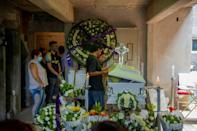 People attend the wake of 12-year-old Brandon Giovanny Hernandez Tapia who died in the metro disaster