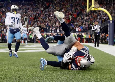 Jan 13, 2018; Foxborough, MA, USA; New England Patriots tight end Rob Gronkowski (87) makes a touchdown catch against Tennessee Titans free safety Kevin Byard (31) during the fourth quarter in the AFC Divisional playoff game at Gillette Stadium. Mandatory Credit: Winslow Townson-USA TODAY Sports