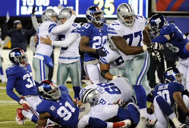 Dallas Cowboys kicker Dan Bailey (5) is congratulated by Chris Jones (6) after Bailey kicked a game-winning field goal against the New York Giants during the second half of an NFL football game, Sunday, Nov. 24, 2013, in East Rutherford, N.J. The Cowboys won 24-21. (AP Photo/Bill Kostroun)