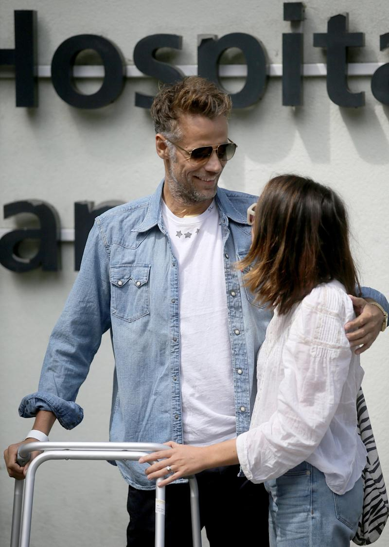 Recovering: Richard Bacon leaving hospital after coming out of a medically induced coma (SplashNews.com)