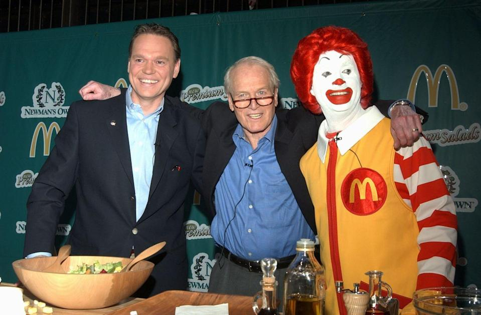 <p>McDonald's was pressured to provide healthier menu options in 2003. So what'd they do? Launch entrée salads served with (wait for it) Paul Newman's popular salad dressings. Here, the actor celebrates the launch alongside Ronald McDonald and a McDonald's executive in Times Square.<br></p>