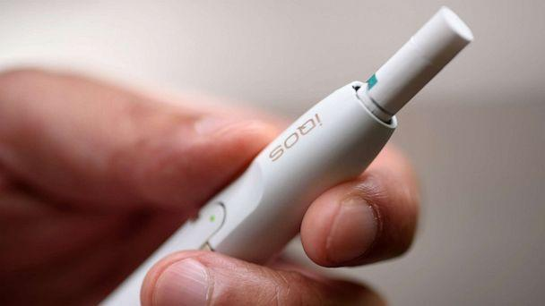 PHOTO: A man holds an iQOS electronic cigarette in Tokyo, Aug. 23, 2016. This product is heated (not burned) and consumed in battery-charged device, seeking to appeal to smokers who want their nicotine fix without the usual smell and smoke.  (Bloomberg via Getty Images, FILE)