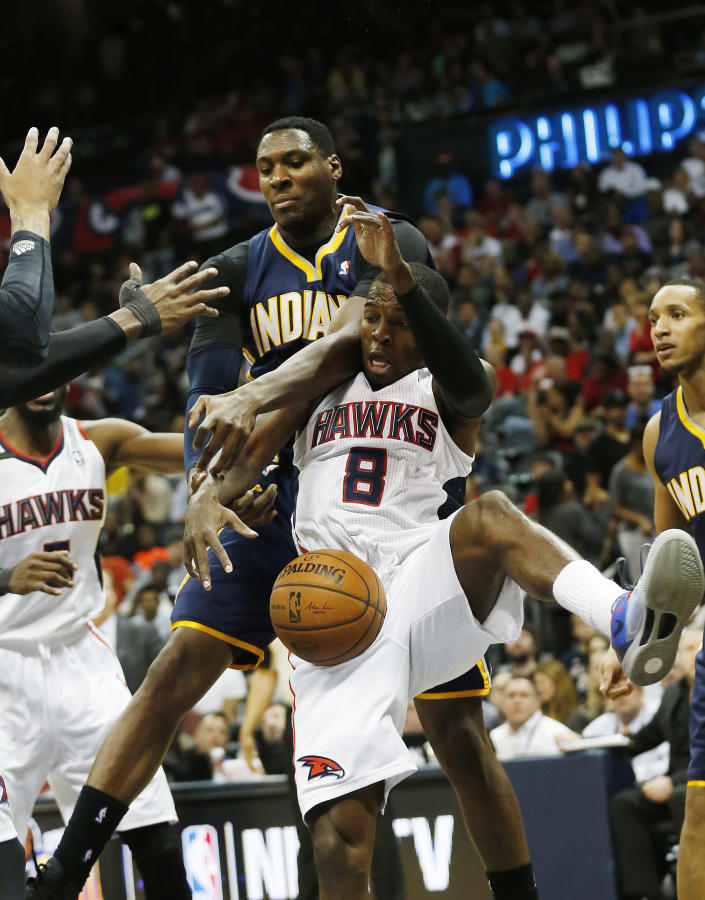 Atlanta Hawks guard Shelvin Mack (8) and Indiana Pacers center Ian Mahinmi battle for a rebound in the first half of Game 3 of an NBA basketball first-round playoff series on Thursday, April 24, 2014, in Atlanta. (AP Photo/John Bazemore)