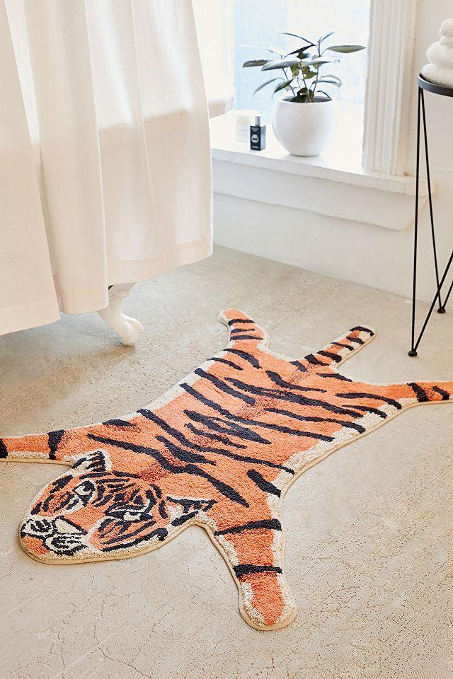 "<h2>Urban Outfitters Tiger Bath Mat</h2><br>Bath mats make for fantastic funky rugs; they often come in much more offbeat shapes with machine-washable fabrics that stand the test of feet and time. <br><br><em>Shop <strong><a href=""https://www.urbanoutfitters.com/shop/tiger-shaped-bath-mat"" rel=""nofollow noopener"" target=""_blank"" data-ylk=""slk:Urban Outfitters"" class=""link rapid-noclick-resp"">Urban Outfitters</a></strong></em><br><br><strong>Urban Outfitters</strong> Tiger Bath Mat, $, available at <a href=""https://go.skimresources.com/?id=30283X879131&url=https%3A%2F%2Fwww.urbanoutfitters.com%2Fshop%2Ftiger-shaped-bath-mat"" rel=""nofollow noopener"" target=""_blank"" data-ylk=""slk:Urban Outffiters"" class=""link rapid-noclick-resp"">Urban Outffiters</a>"