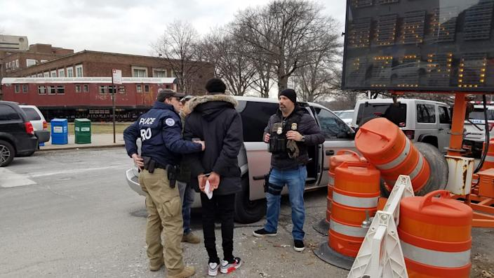 Immigration agents arrest a man outside Queens Criminal Court in this month. (Photo: Immigrant Defense Project)