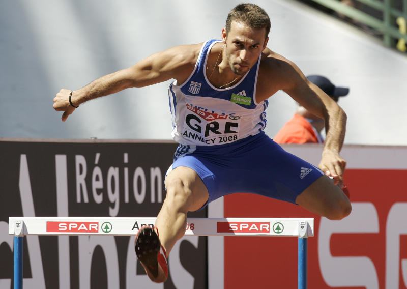 "FILE - In this Saturday, June 21, 2008 file photo, Periklis Iakovakis of Greece competes during the 400m hurdles race at the SPAR European Cup 2008 in Annecy, southeastern France.  For athletes, like Iakovakis, from crisis-hit European nations preparing for the London Games, there are obstacles beyond training. ""Of course, the crisis affects you because the world of athletics, the world of sports, it is part of society,"" Iakovakis told The Associated Press. ""If you consider I have a family and I have two children, everything is inside my mind because I also have to think of the future."" (AP Photo/Lionel Cironneau)"