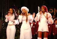 <p>Looking festive in matching white outfits with at the 2001 Rockefeller Center Christmas tree lighting ceremony.</p>