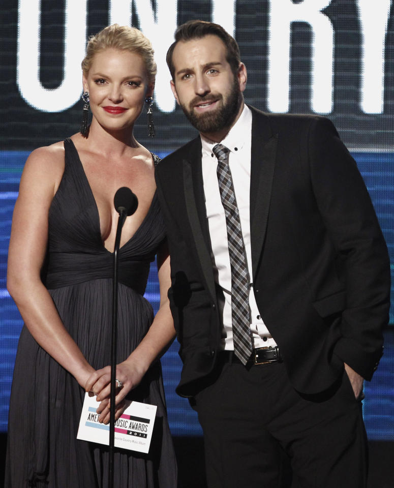 Katherine Heigl and Josh Kelley are seen onstage at the 39th Annual American Music Awards on Sunday, Nov. 20, 2011 in Los Angeles. (AP Photo/Matt Sayles)