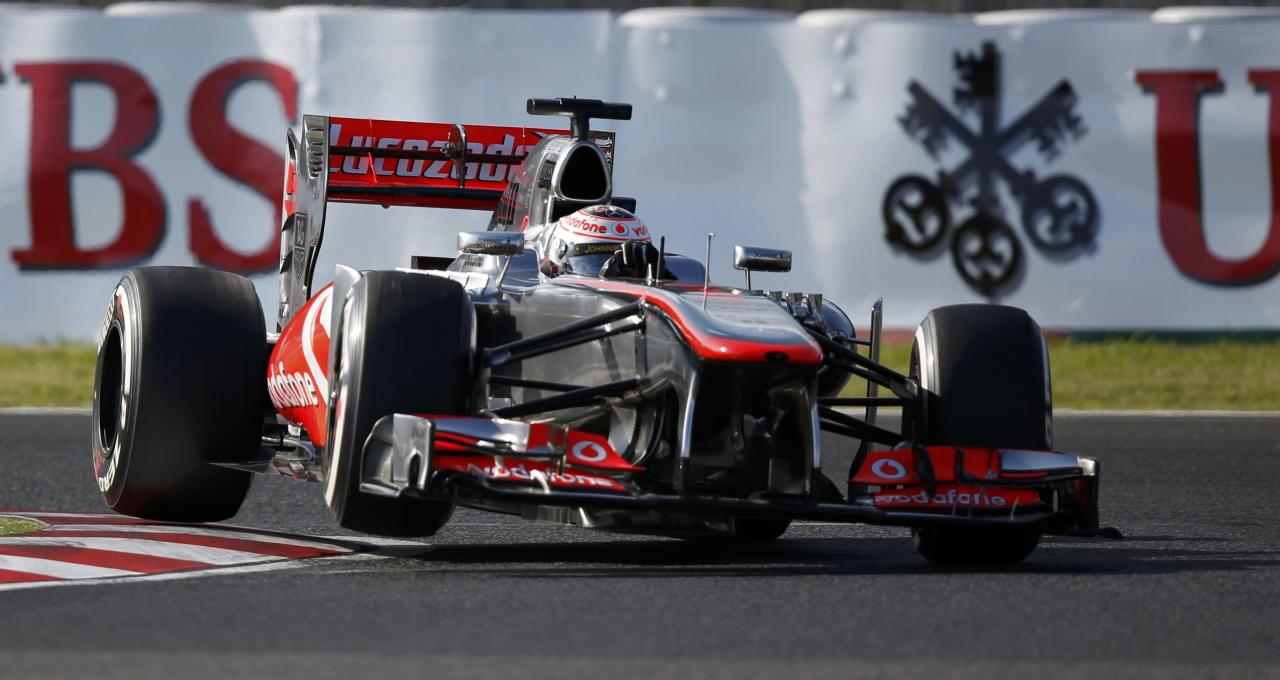 McLaren Formula One driver Jenson Button of Britain drives during the qualifying session of the Japanese F1 Grand Prix at the Suzuka circuit October 12, 2013. REUTERS/Toru Hanai (JAPAN - Tags: SPORT MOTORSPORT F1)