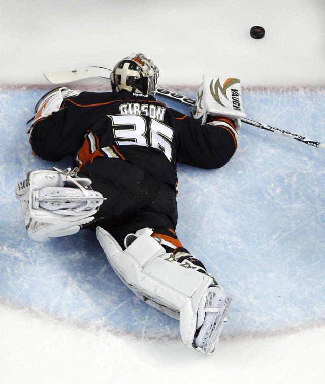 Anaheim Ducks goalie John Gibson watches a goal by Los Angeles Kings right wing Justin Williams during the first period in Game 7 of an NHL hockey second-round Stanley Cup playoff series in Anaheim, Calif., Friday, May 16, 2014. (AP Photo/Chris Carlson)