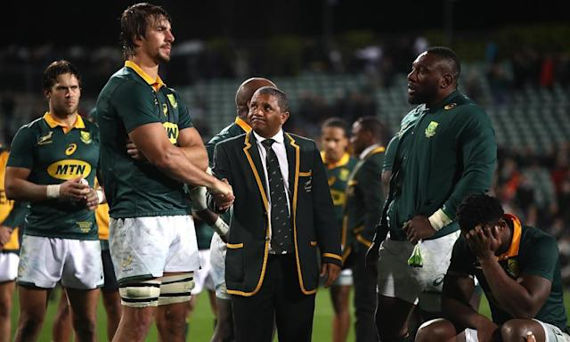 """<span class=""""element-image__caption"""">South Africa players and officials look distraught after their 57-0 drubbing by the All Blacks in Auckland on Saturday, a 14th defeat in their last 16 Tests.</span> <span class=""""element-image__credit"""">Photograph: Phil Walter/Getty Images</span>"""