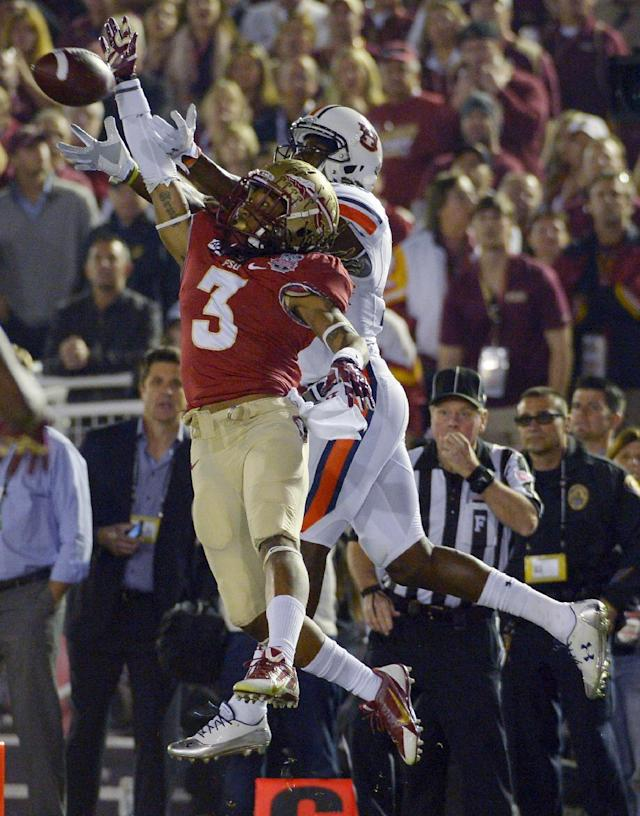Florida State's Ronald Darby (3) breaks up a pass intended for Auburn's Sammie Coates during the first half of the NCAA BCS National Championship college football game Monday, Jan. 6, 2014, in Pasadena, Calif. (AP Photo/Mark J. Terrill)