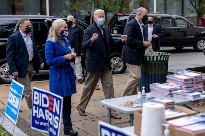 Democratic presidential candidate former Vice President Joe Biden arrives to speak with supporters outside a voter service center, Monday, Oct. 26, 2020, in Chester, Pa. (AP Photo/Andrew Harnik)