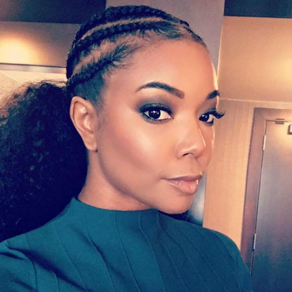 Braiding cornrows back into a faux pony gives you the best of both worlds: intricate style and maximum volume. If you've been looking to experiment with color, you can weave it in the cornrows or just add in a bright pony to create a color block effect. Either way is guaranteed to look cute.