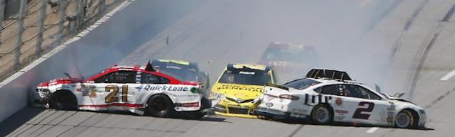 Matt Kenseth (20) moves through Trevor Bayne (21) and Brad Keselowski (2) coming out of Turn 4 during the NASCAR Aaron's 499 Sprint Cup series auto race at Talladega Superspeedway, Sunday, May 4, 2014, in Talladega, Ala. (AP Photo/John Bazemore)