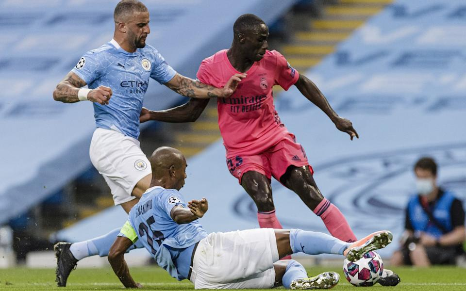 Ferland Mendy of Real Madrid (R) battles for the ball with Fernandinho Roza (C) and Kyle Walker of Manchester City  - Getty Images