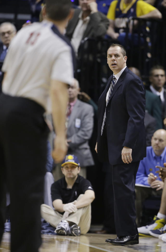 Indiana Pacers head coach Frank Vogel looks at referee Monty McCutchen after being called for a technical foul during the second half in Game 5 of an opening-round NBA basketball playoff series against the Atlanta Hawks Monday, April 28, 2014, in Indianapolis. Atlanta defeated Indiana 107-97. (AP Photo/Darron Cummings)