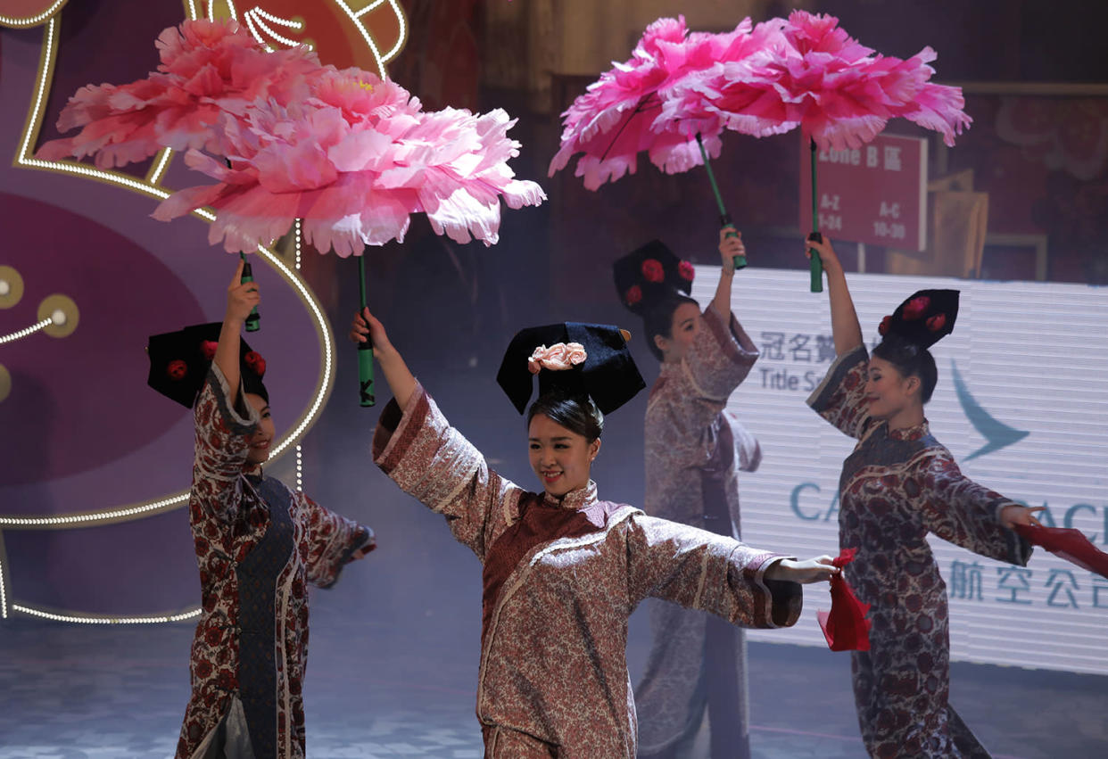Performers take part in a night parade to celebrate Chinese New Year in Hong Kong, Saturday, Jan. 28, 2017. The Lunar New Year this year marks the Year of the Rooster in the Chinese calendar. (AP Photo/Vincent Yu)