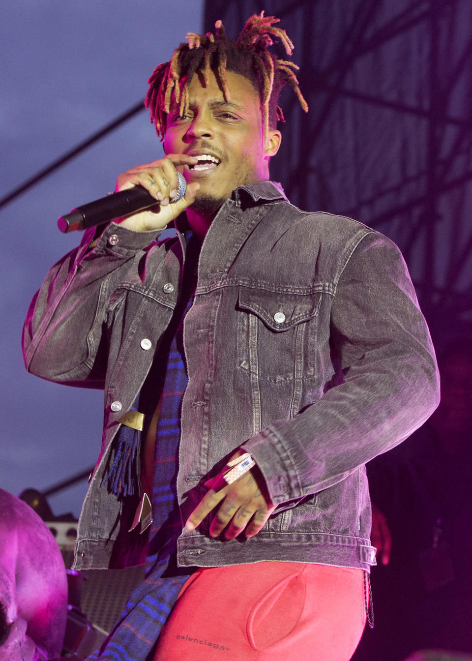 """FILE - In this May 15, 2019 file photo, Juice WRLD performs in concert during his """"Death Race for Love Tour"""" at The Skyline Stage at The Mann Center for the Performing Arts in Philadelphia. The 21-track album """"Legends Never Die"""" set several records when it debuted at No. 1 on the Billboard 200 albums chart, but failed to receive a Grammy nomination. (Photo by Owen Sweeney/Invision/AP, File)"""