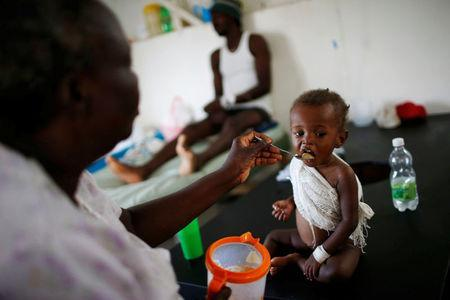 People are treated at a cholera treatment center at a hospital after Hurricane Matthew passed through Jeremie, Haiti, October 11, 2016. REUTERS/Carlos Garcia Rawlins