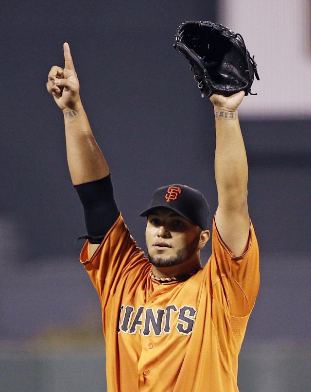San Francisco Giants starting pitcher Yusmeiro Petit holds up one finger on the mound at the end of their baseball game against the Arizona Diamondbacks Friday, Sept. 6, 2013, in San Francisco. San Francisco won the game 3-0 and Petit pitched a one-hitter. (AP Photo/Eric Risberg)