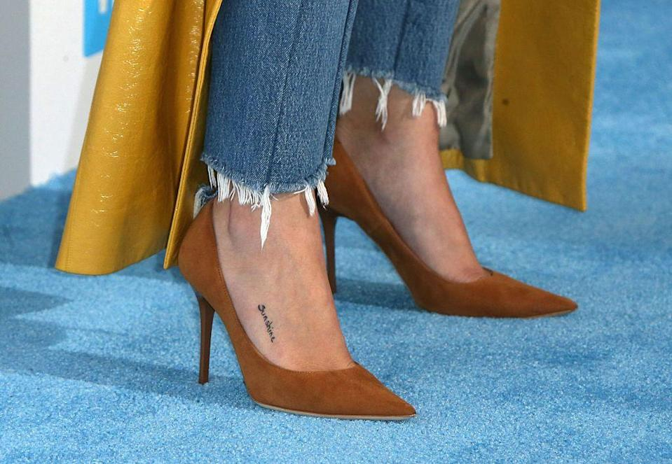 <p>Gomez has one tattoo on her foot which spells out 'sunshine'.</p>