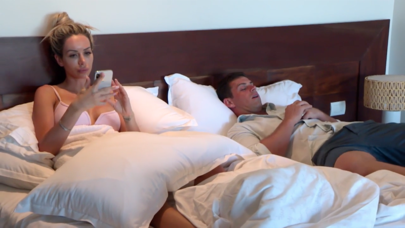 mafs bride stacey sits on phone while husband Michael sleeps