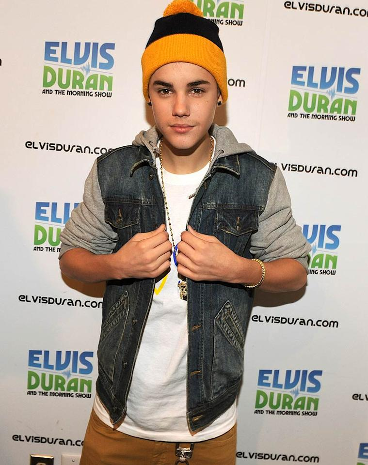 Justin Bieber struck a pose at the Z100 radio studio in NYC before heading in to be interviewed on The Elvis Duran Morning Show. Is it us, or does it look like JBiebs is sporting a little fuzz above his lip?! (11/17/2011)