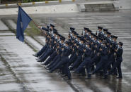 "Hong Kong police show their new goose step marching style on the National Security Education Day at a police school in Hong Kong Thursday, April 15, 2021. Authorities in Hong Kong are marking the day with a police college open house, where police personnel demonstrated the Chinese military's ""goose step"" march, replacing British-style foot drills. The ""goose step"" march is one in which troops swing their legs off the ground in unison, keeping each leg straight. (AP Photo/Vincent Yu)"