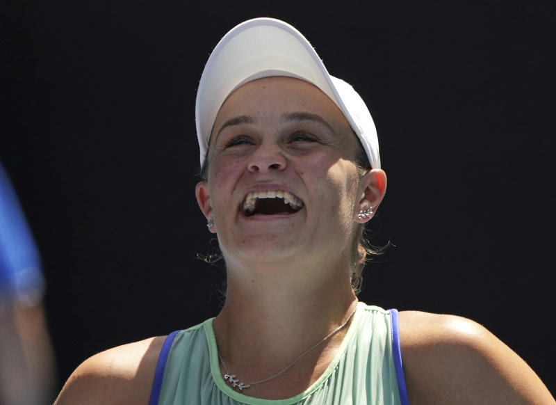 Australia's Ashleigh Barty laughs during a post match interview following her win over Petra Kvitova of the Czech Republic in their quarterfinal match at the Australian Open tennis championship in Melbourne, Australia, Tuesday, Jan. 28, 2020. (AP Photo/Lee Jin-man)
