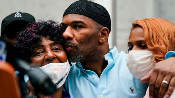 PHOTO: Eric Riddick, center, embraces his mother Christine Riddick, left, and wife Dana Baker-Riddick as they listen during a news conference in Philadelphia, Friday, May 28, 2021. (Matt Rourke/AP)