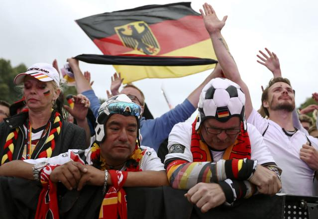Soccer Football - World Cup - Group F - Germany vs Sweden - Berlin, Germany - June 23, 2018 Germany soccer fans react as they watch match at public viewing area at Brandenburg Gate. REUTERS/Christian Mang