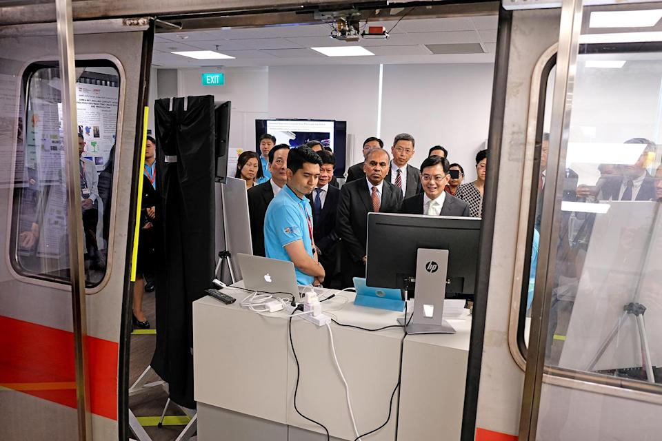 Finance Minister Heng Swee Keat (right, in glasses) attending the official opening of the SMRT-NTU Smart Urban Rail Corporate Laboratory on 29 August, 2018. (PHOTO: NTU)