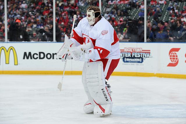 DETROIT, MI - DECEMBER 31: Goaltender Eddie Mio #41 of the Detroit Red Wings blocks a shot from the Toronto Maple Leafs in the first period during the 2013 Hockeytown Winter Festival Alumni Showdown on December 31, 2013 at Comerica Park in Detroit, Michigan. (Photo by Jamie Sabau/Getty Images)