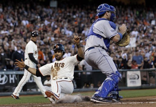 San Francisco Giants' Angel Pagan slides past Los Angeles Dodgers catcher A.J. Ellis to score on a single by Pablo Sandoval during the fourth inning of a baseball game in San Francisco, Tuesday, June 26, 2012. (AP Photo/Jeff Chiu)