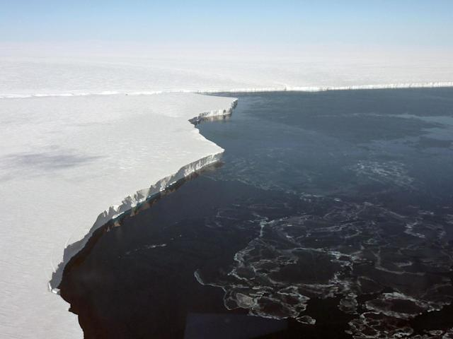<p>The Getz Ice Shelf extends several miles into the ocean from the Getz Glacier as it empties into the ocean along the Antarctic coast, Nov. 5, 2010. The vertical face of the ice shelf is almost 200 feet high and is estimated to extend another 1000 feet below the ocean surface. (Photo: NASA/Dick Ewers) </p>