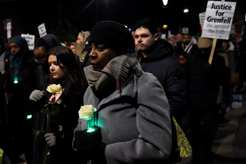 The silent candlelit march marked the six month anniversary of the Grenfell Tower fire: REUTERS