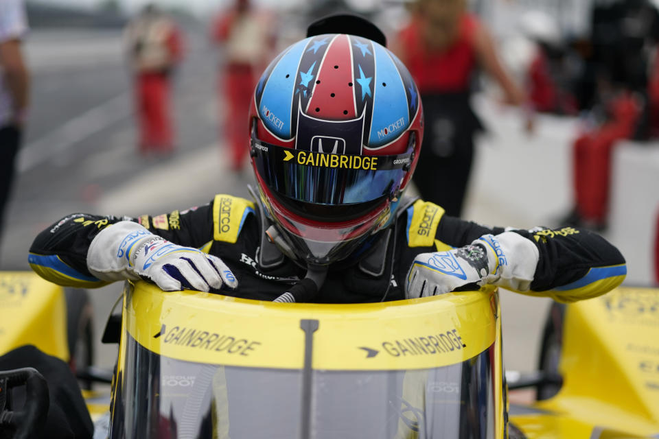 Colton Herta climbs out of his car during qualifications for the Indianapolis 500 auto race at Indianapolis Motor Speedway, Saturday, May 22, 2021, in Indianapolis. (AP Photo/Darron Cummings)